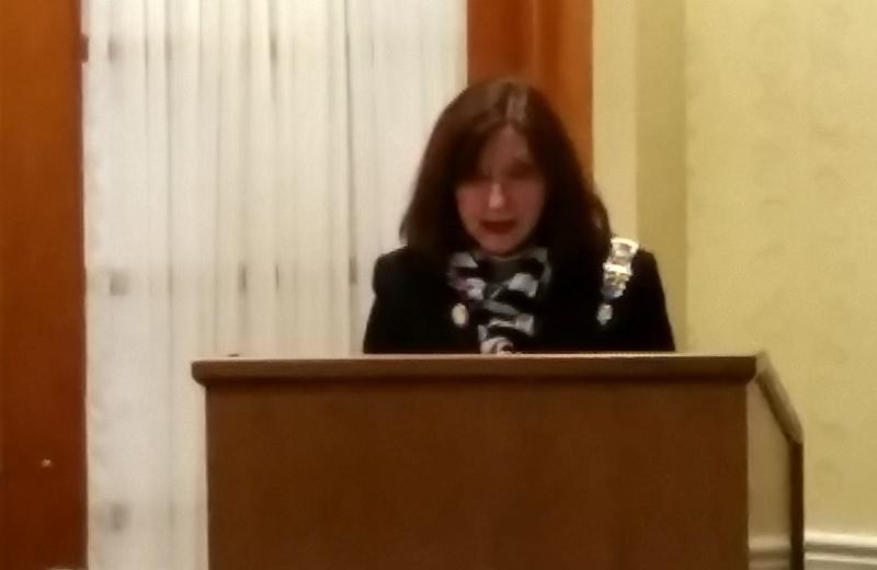 visiting author speaks at podium