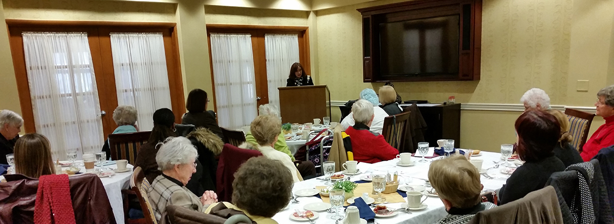 members at luncheon listening to author speaking