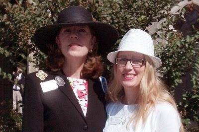two members wearing hats