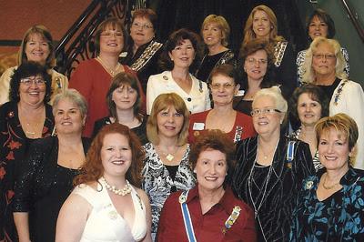 nineteen women standing in group