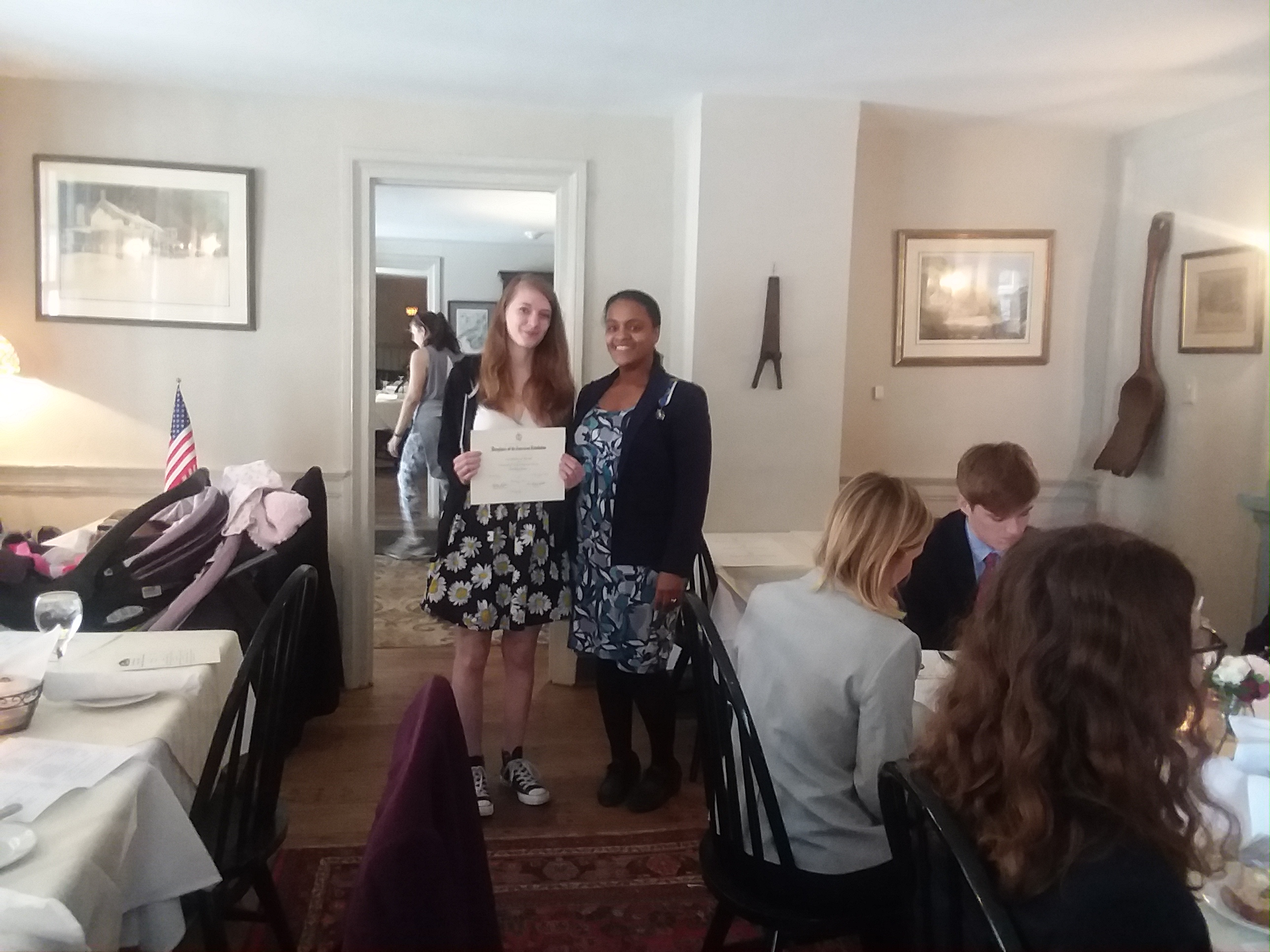 Regent standing with student holding award