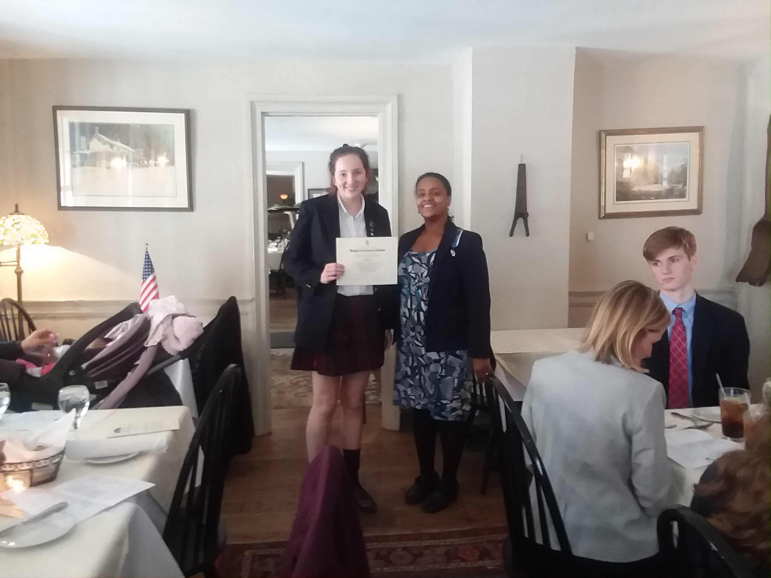 student holding award with Regent