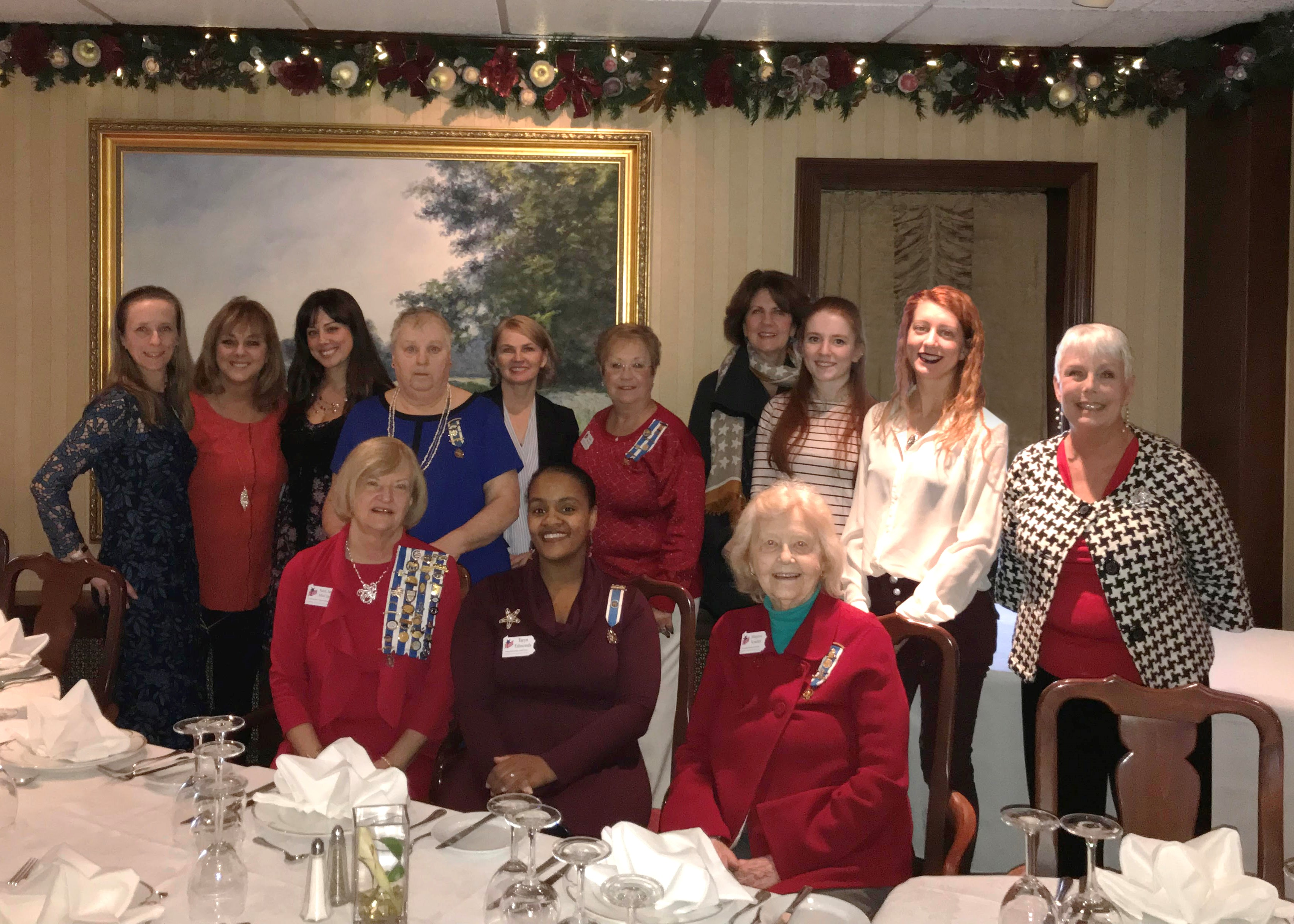 Members standing together after holiday luncheon