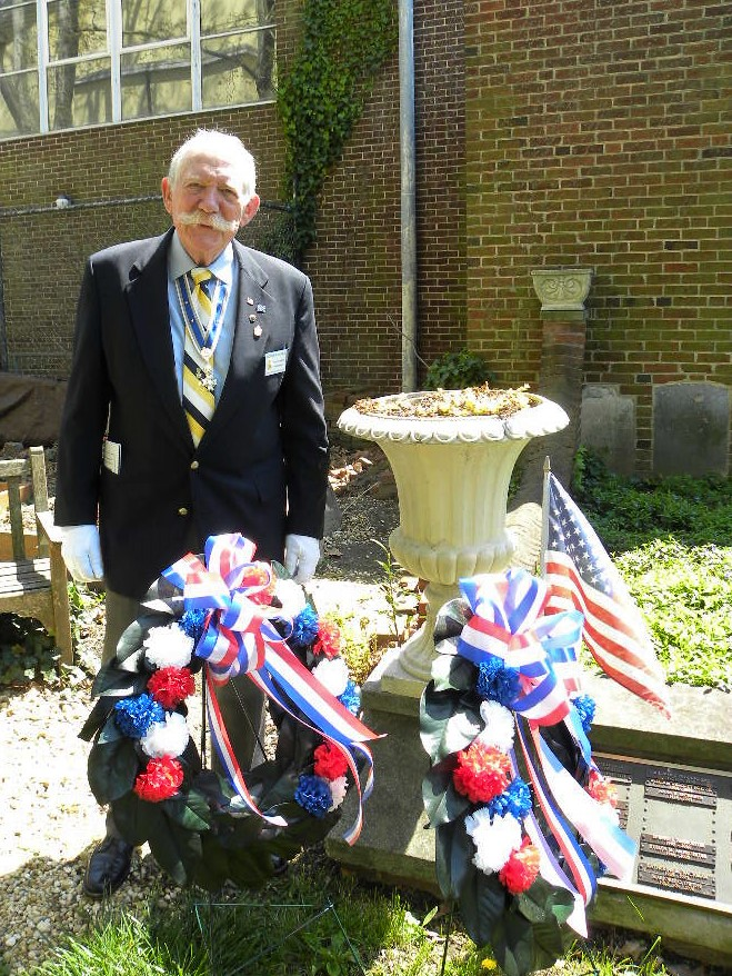 Clark standing by patriotic ribbon decorations