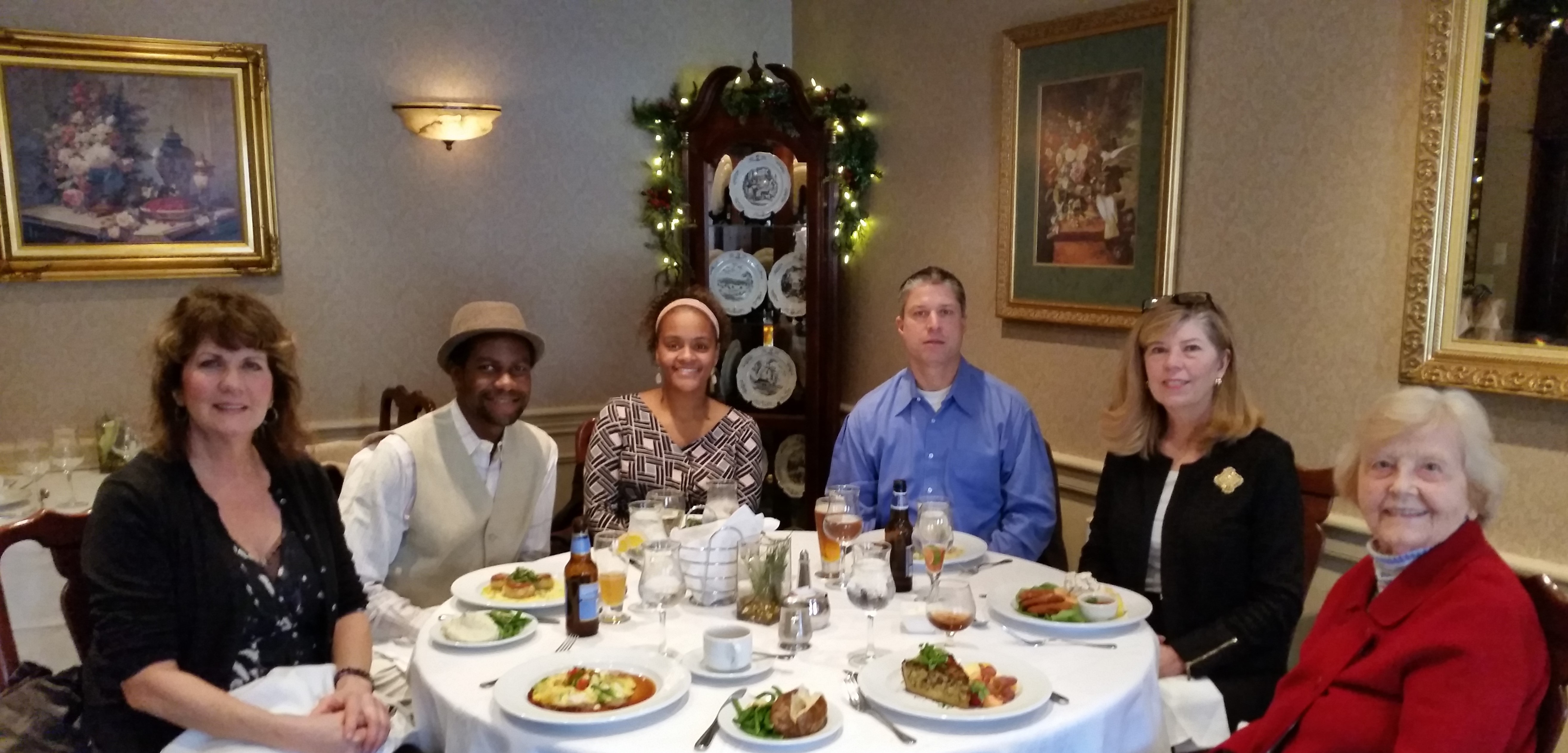 six members seated at holiday luncheon