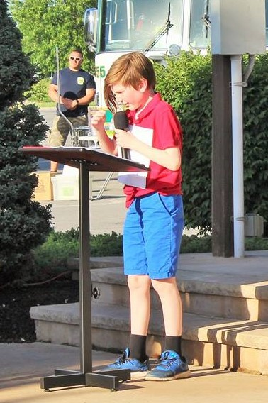 child speaking at podium